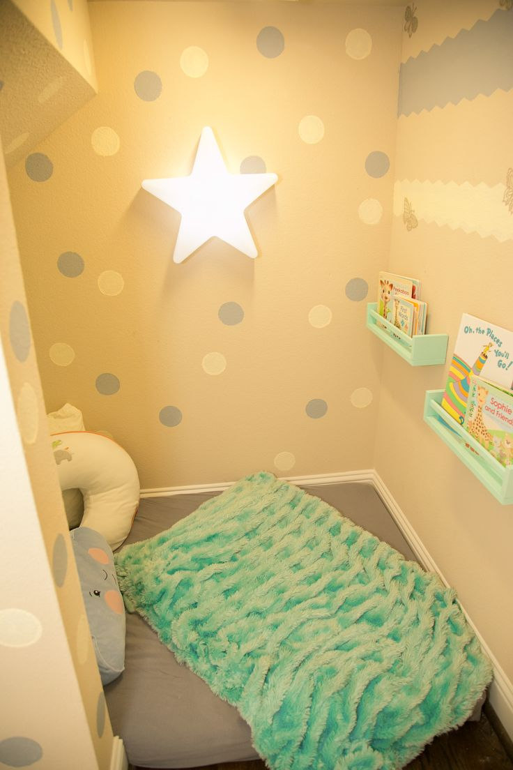 This is part of our under the stairs space in our home! It is a pretty large space, Imagine boxes to the ceiling! You couldnt even walk in there! I have a 5 year old and his playroom has way to many small objects that are dangerous for my crawling 6 month old! This space is off my kitchen and Living area and a safe space for my daughter to play!
