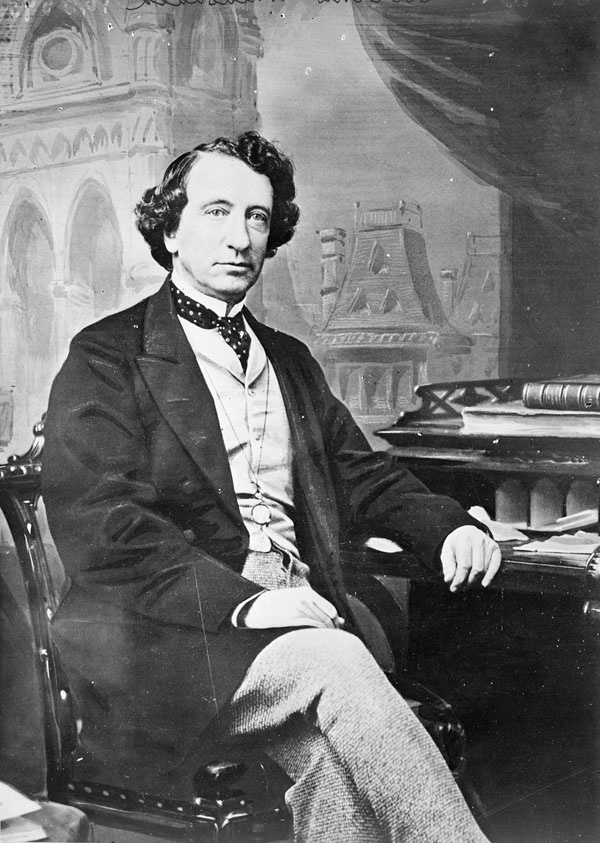 Sir John A. Macdonald  (1815 – 1891) was born in Scotland.  He was the first Prime Minister of Canada. The dominant figure of Canadian Confederation, his political career spanned almost half a century. Macdonald served 19 years as Canadian Prime Minister (the 2nd longest). He lost office for 5 years in the 1870s over the Pacific Scandal (bribery in the financing of the CPR). After regaining his position, he saw the railroad through to completion in 1885, which helped unite Canada.