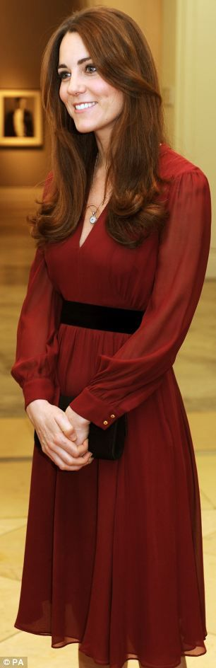 The Duchess of Cambridge wore burgundy 'Sofie Rae' dress from Whistles. #katemiddleton  See more fashion details at:  http://whatkatewore.com/2013/01/11/kate-in-whistles-for-portrait-unveiling-celebrates-birthday-at-cirque-de-soleil/