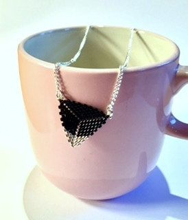 """An Elegant Hand Beaded Triangle """"Bunting"""" Necklace in Black and Silver by LetsGetBusyBeading on Etsy"""