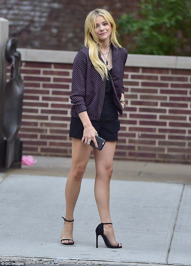 Street style! Chloe Grace Moretz looks stunning in a trendy bomber jacket and playsuit whi...