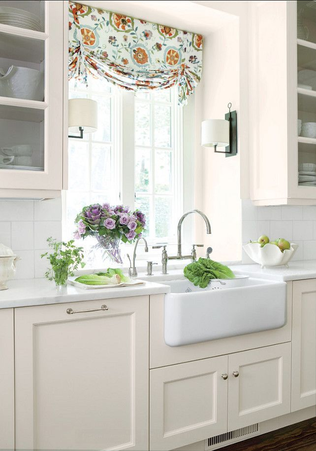 Side sconces add additional light while also adding character and an element of customization to this farmhouse-style kitchen.