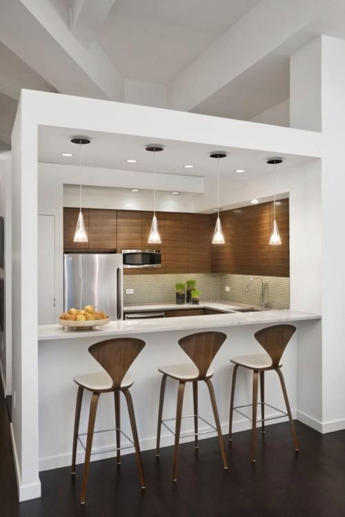 Love the lights over the bench in this compact kitchen. pinned with Pinvolve
