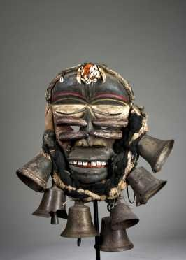 Guere-Wobe war mask,  Ivory Coast H: 13 (excl. attachments) The powerful male mask with rounded forehead, deep furrowed brow, and white clamshel...
