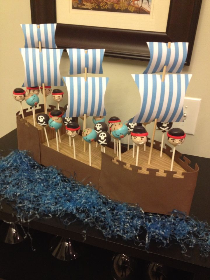 Jake and the Neverland pirates cake pops. The pirate ship cake pop stand was also designed be me.
