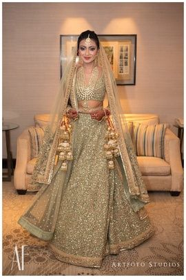 Beautiful Dull Mint and Gold Shimmer Lehenga With Gold/Bronze Makeup and Blood Red Lipstick