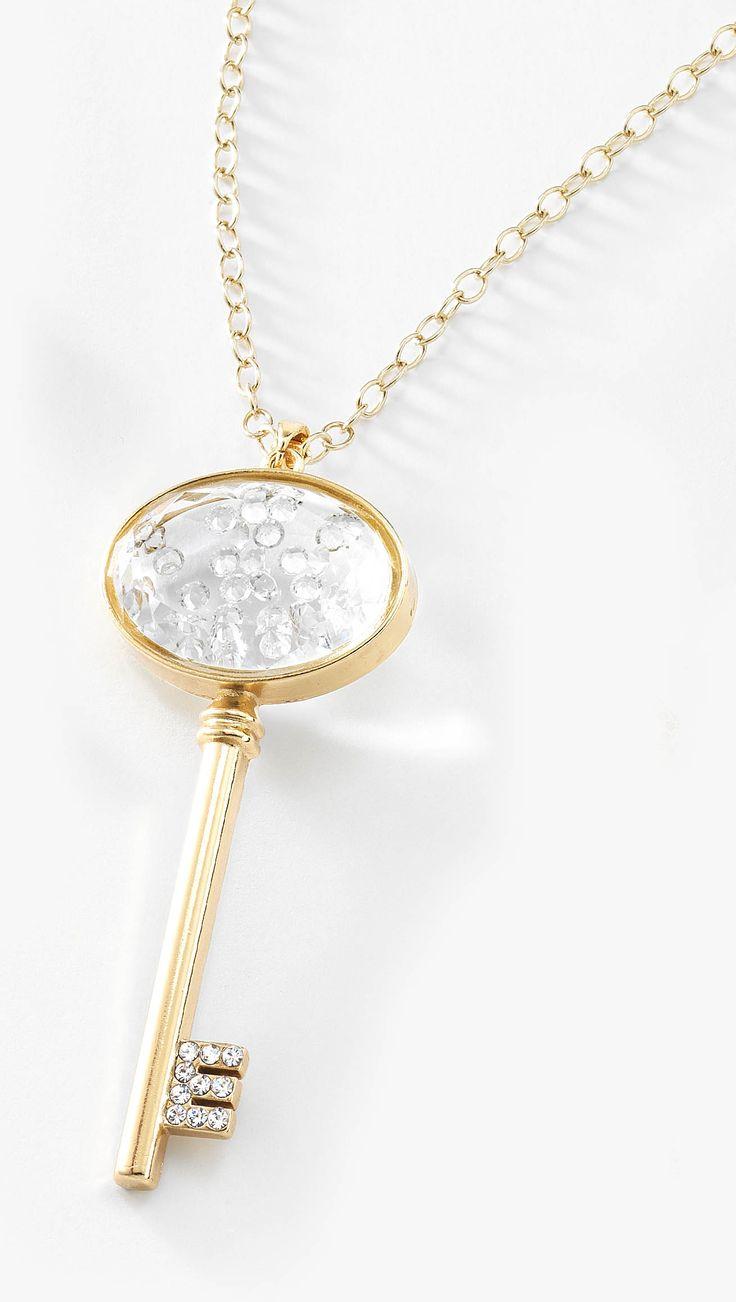 Colgante de llave con piedra de cristal incrustrada en 4 baños de oro de 18 kt. Modelo 415453.