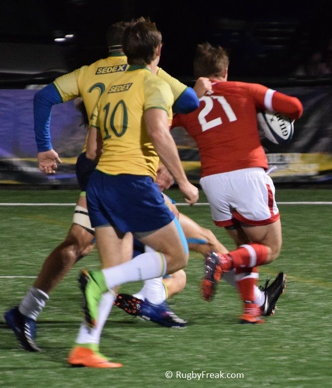 Brazilian rugby player trying to hold on to Canadian player. #rugbyfreak #sofreaky #loverugby #ARC #rugby #rugbycanada #teamcanada #teambrazil