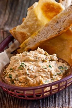 Austrian RECIPE - LIPTAUER CHEESE SPREAD you will surely get at the Heurigen (wine taverns) around Vienna. Liptauer cheese spread is typically eaten as an appetizer or snack with dark rye bread, radishes, hard-cooked eggs, green onions, green pepper.