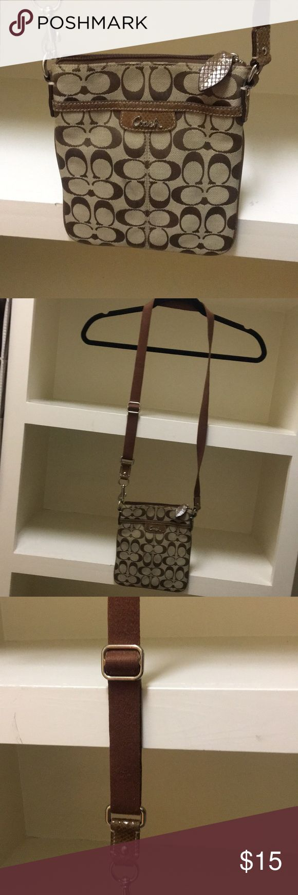 Coach brown leather crossbody Brown signature coach purse. Great condition. No flaws. Rarely used. Rust red lining. Back zipper pocket. Coach Bags Crossbody Bags