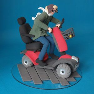 65th birthday cake topper, man on a mobility scooter