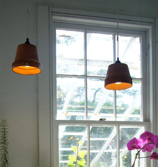 """Robin Horton of Urban Gardens came up with this clever DIY lamp for a potting shed they converted into a """"Creative Garden Retreat"""". They used ordinary reclaimed terra cotta garden pots, turned them upside down, added a ceiling cord set, and hung them as ceiling pendant lamps, bringing a bit of garden to an indoor room."""