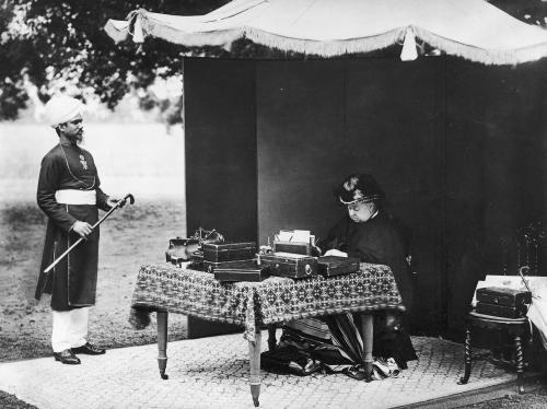 """The """"Empress of India"""" with her 'munshi' (clerk) Abdul Karim 1896.  Although Queen Victoria never set foot in India, she added the Dunbar Room to Osborne house, (1890-1) for state functions, complete with an Agra carpet, a model of a Mughal palace, Indian painting collection and an Indian clerk seen here who lived on the estate until her death."""