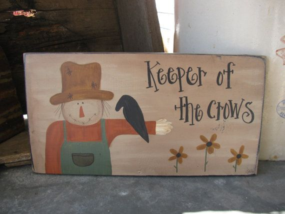 Primitive scarecrow with crow and sunflowers hand painted sign. I love scarecrows in fall. Ive hand painted this scarecrow with a crow perched