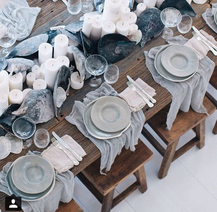 Natural beach inspired tablescape with candles and linens