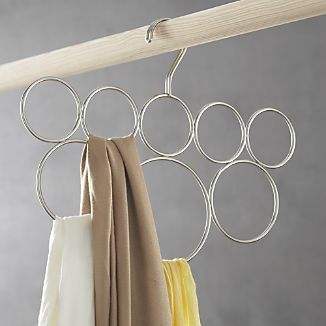 I'm not a big scarf wearer, but I could definitely see using this for belts, too.   Classico 8-Loop Scarf Hanger I Crate and Barrel