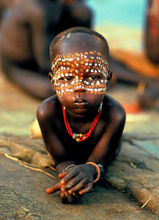 "Africa | ""No matter how young, Surma children love to be decorated with vibrantly colored face paint. Their colorful bead necklaces are received in the first years of life."" Ethiopia. 
