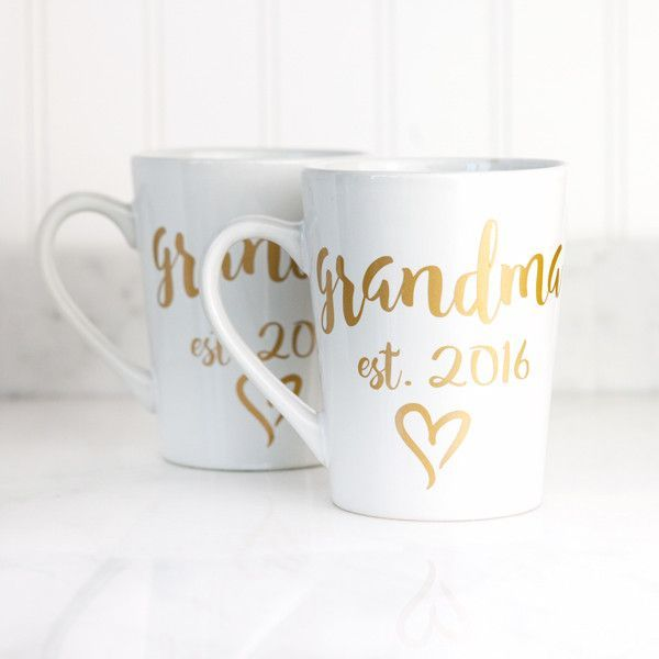 "The perfect gift for any new grandmother, or a great way to break the news to a grandmother-to-be! This 14 oz mug features the words ""grandma est. 2016"" in our beautiful gold script lettering. Also ma"