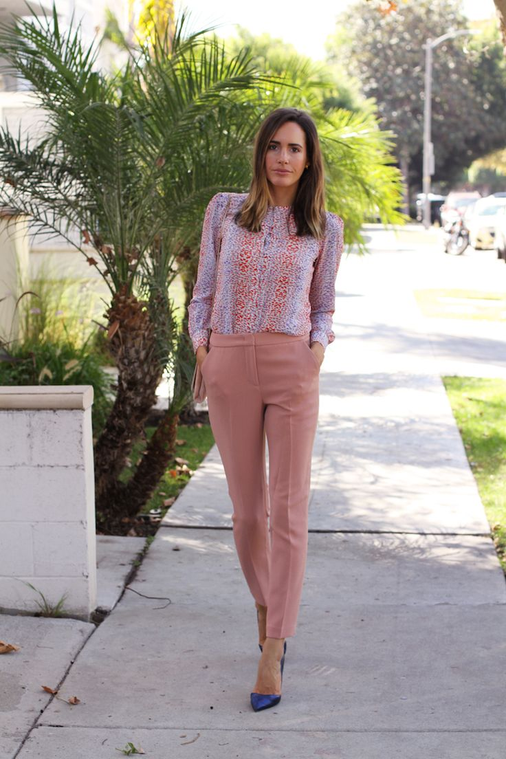 Trousers by Reiss, Shoes by Kurt Geiger, Blouse by Reiss, Handbag by Huxley & Cox, Rings by Kelly Wearstler and Giles & Brother, Earrings by Accessorize