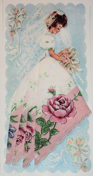 Roses and Teacups:  Vintage Handkerchief,  folded to create a wedding dress on card.  http://roses-and-teacups.com/2012Hankies/bride3.jpg  http://www.roses-and-teacups.com/PDGImages/-6276491488901823999_1.jpg  http://roses-and-teacups.com/2013Hankies/whitebridal1.jpg  http://roses-and-teacups.com/2013Hankies/whiteeye.jpg