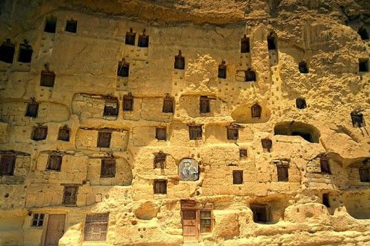 Centuries old manazan vertical cave city is carved out of a sheer rock wall, in the Karaman region of Central Turkey