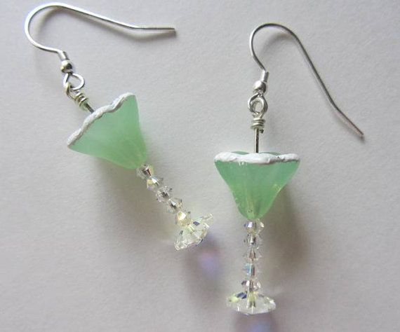 Margarita glasses with a salted rim are so much fun to wear! Swarovski crystal AB bicones make up the stem, and Swarovski crystal AB margarita beads make up the base. The glass is an opaque lime green Czech glass bead, and Ive painted the rim to look like its been salted. They hang from sterling silver earwires, and measure a total of approximately 1-1/2 long.  First class mail shipping is free to US addresses.