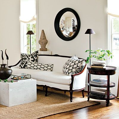 Rethink trad-style furniture! Simply reupholstering this sofa (formerly pink) in a white outdoor fabric resulted in a modern sofa with classic lines.