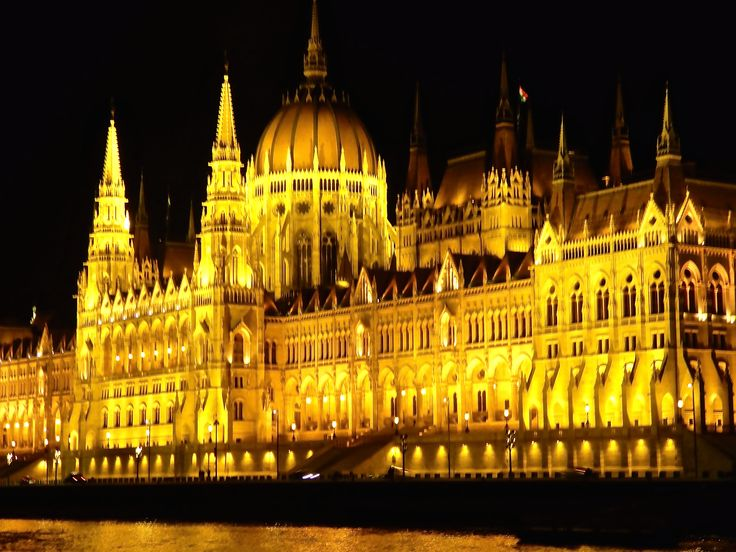 The Parliament building at night as seen from the Danube