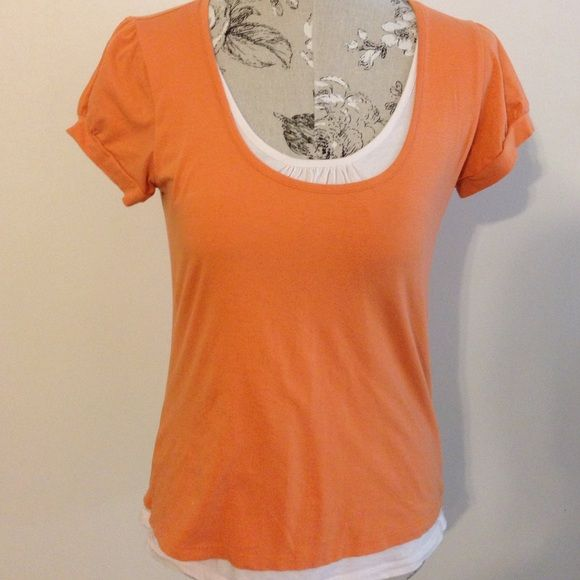 Michael Kors Orange Short Sleeve Top M Top is made to look like you are wearing under shirt. Has extra piece around neck and bottom. Excellent condition. MICHAEL Michael Kors Tops