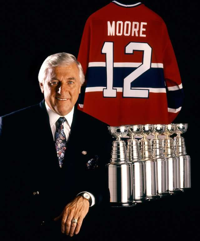 Montreal Canadiens legend Dickie Moore with six miniature Stanley Cups, representing his championships won with the Canadiens during his 12-season Habs career from 1951-63.