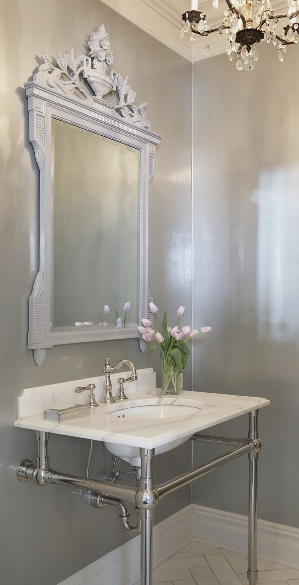 Elegant and simple but absolutely stunning!! Just love the frame around the mirror and the simple white and silver colour theme. You could add any colour flower arrangement to this depending on the look and feel you are going for.