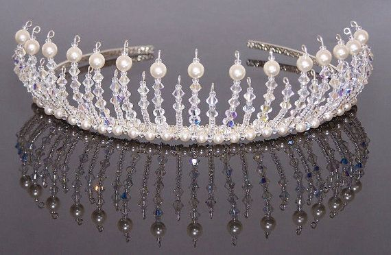 Handmade using SWAROVSKI ELEMENTS -- Swarovski crystals and Swarovski crystal pearls.  This beautiful Diana tiara is just stunning; sure to make you sparkle on your special day. Sparkling Swarovski crystals have been lined with seed beads topped with a shimmering Swarovski pearl, making this a beautiful timeless headpiece. Looks stunning worn with hair up!  Approximate height of tiara -- 4 cm  Here at Confetti and love designs we believe your dream day should be perfect; lots of effort is…