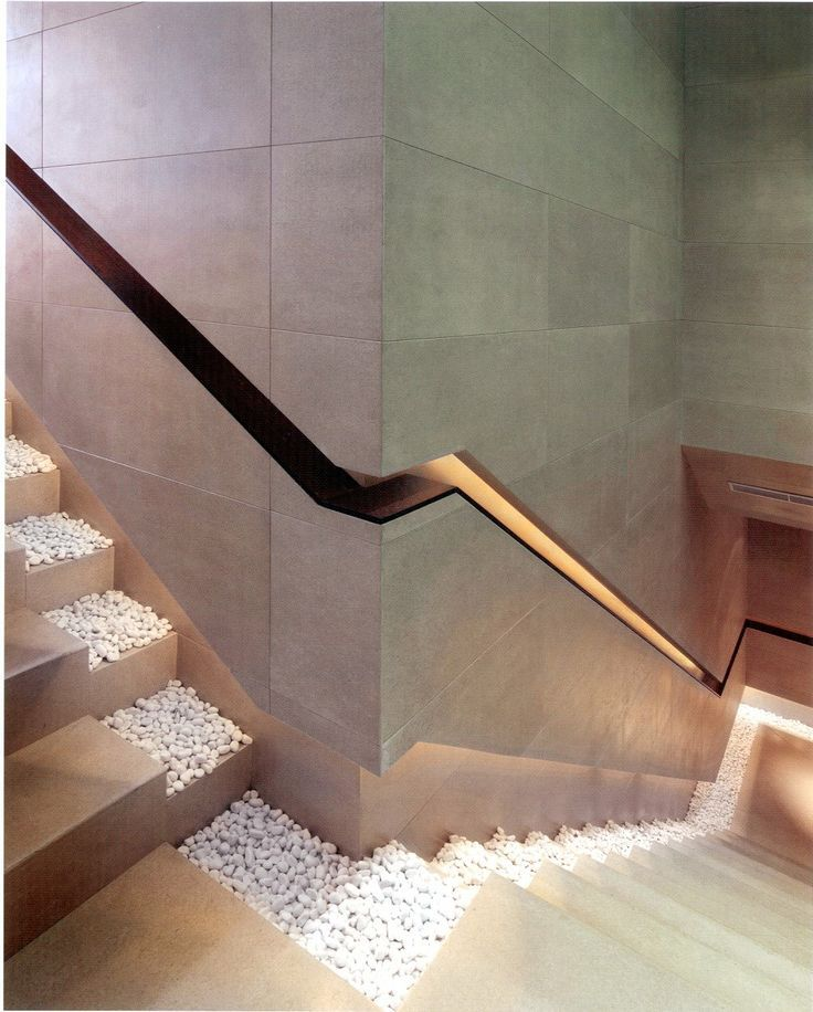 Stunning Designs That Changed The Way We Look At Things. In the case of this staircase, it's actually the recessed lighting and the handrail design that make it so interesting. Plus, those white little pebbles create a really zen and chic ambiance throughout.