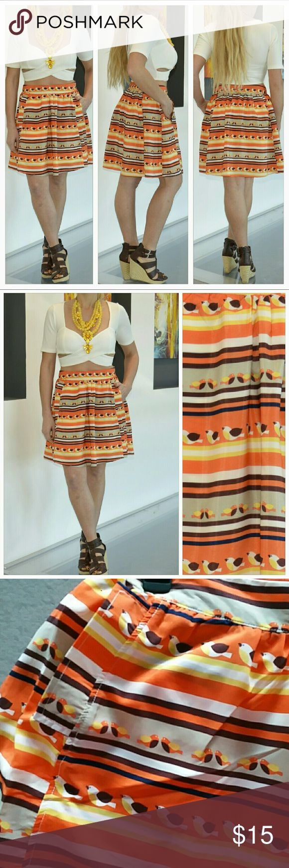 """SALEFUN n' FLIRTY skirt!! Grab this fun & playful skirt for your wardrobe! So cute with little birds flying all over. Colors are tan,brown, orange,yellow & cream Cute pockets in the front, perfect to hide you cell phone or money in. Pair this cutie with a t-shirt, statement necklace and blazer or denim jacket and you are off, looking fabulous!   Brand new, no tags. 100%polyester Length approx 18""""  Cream lining●Pockets in front ●Side zipper.   No trades Price is firm unless bundled Skirts"""