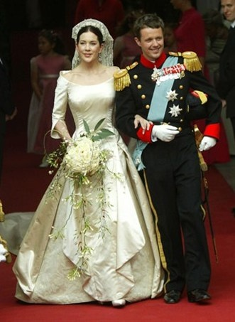 Princess Mary of Denmark and Crown Prince Frederik on their wedding day in 2004. Dress by Uffe Frank.
