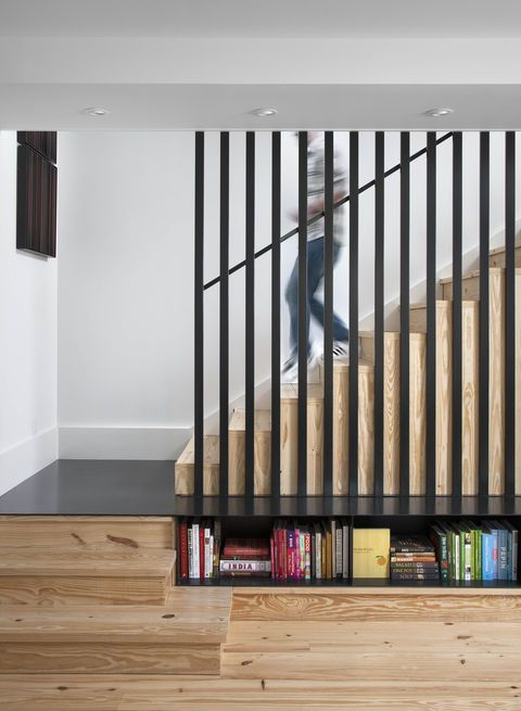 """The caged staircase was designed by architect Patrick Ousey, with whom Flournoy collaborated in the home's design. Although initially unconvinced by the staircase detail, """"it is a great example of how collaboration brings in different perspectives,"""" says Flournoy. Courtesy of: Ryann Ford"""