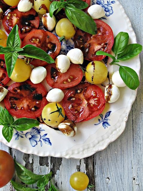 Caprese Salad: Use your freshest tomatoes and some balls of fresh mozzarella or bocconcini. Tear some fresh basil leaves and scatter. Pour a little good olive oil over it all, salt and pepper to taste and reduce balsamic vinegar down until it's almost syrupy. Let it cool, then drizzle over the salad. ❤️