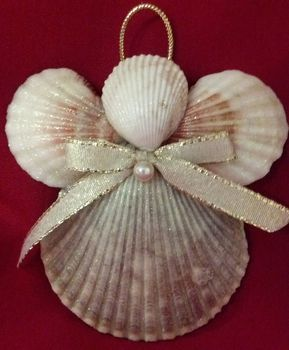 Handmade one of a kind beach decor seashell Christmas angel ornament. This beautiful nautical decor holiday ornament is hand crafted using many different seashells. I have added a bow and attached a ribbon for hanging. This pretty beach ornament makes a perfect addition to your