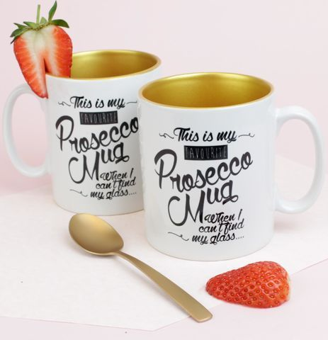 Prosecco printed white mug with gold inside and handwritten slogan.