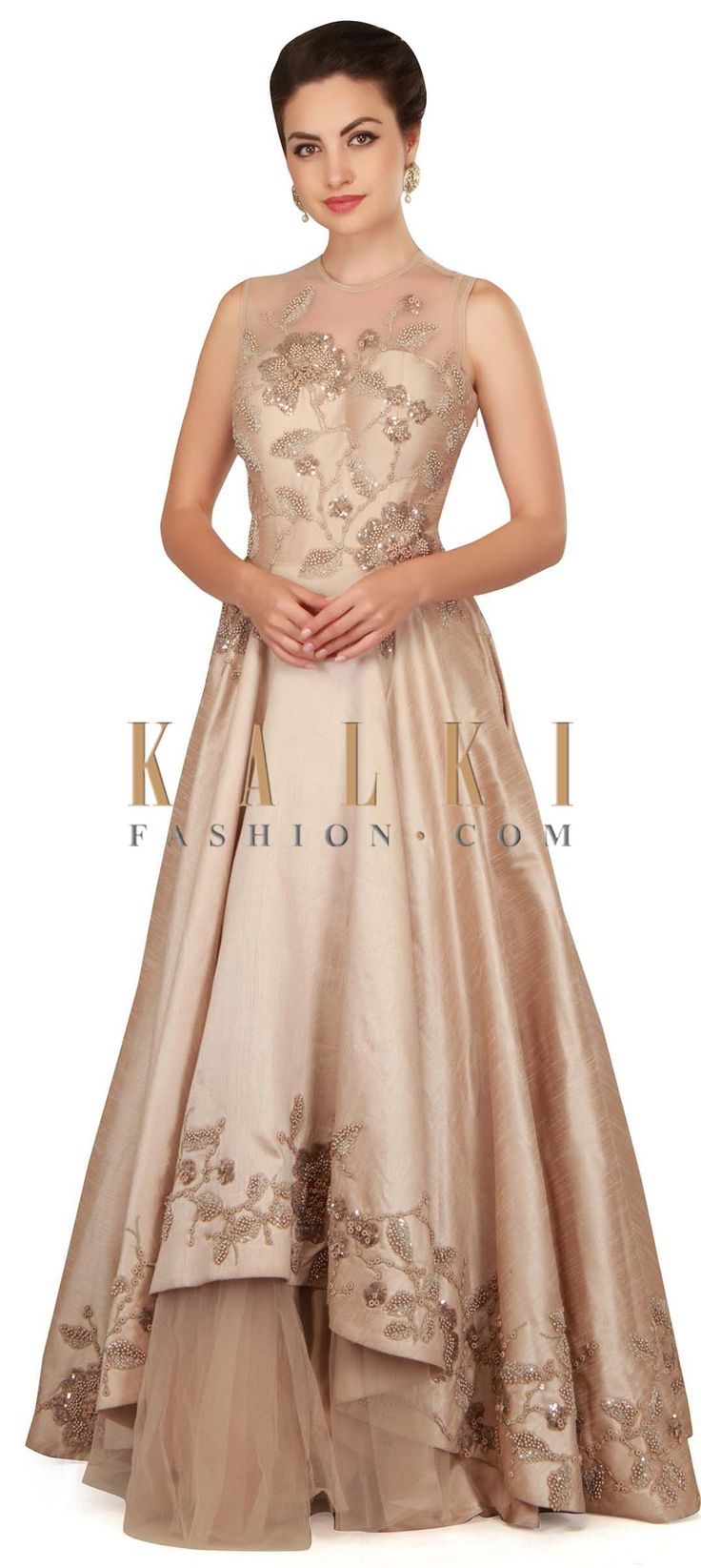 Dull cream gown with bodice and yoke in pearl work only on Kalki