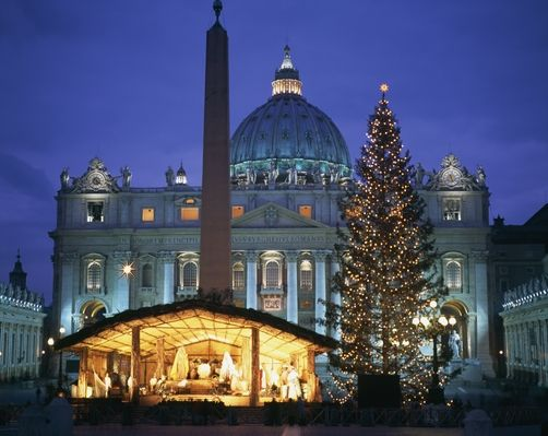 Nativity Scene With Christmas Tree In Piazza San Pietro Outside Of St. Peter's Basilica - Rome, Italy.