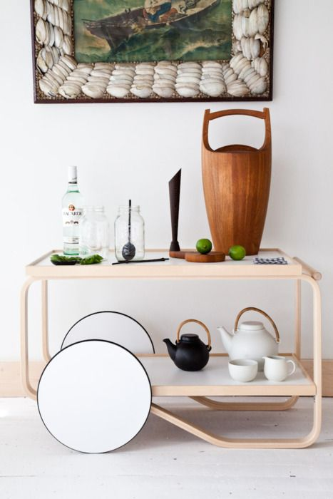 ALVAR AALTO TEA TROLLEY, DANSK ICE BUCKET BY JENS QUISTGAARD, AND GA3 TEA SET BY ULLA PROCOPE FOR ARABIA.