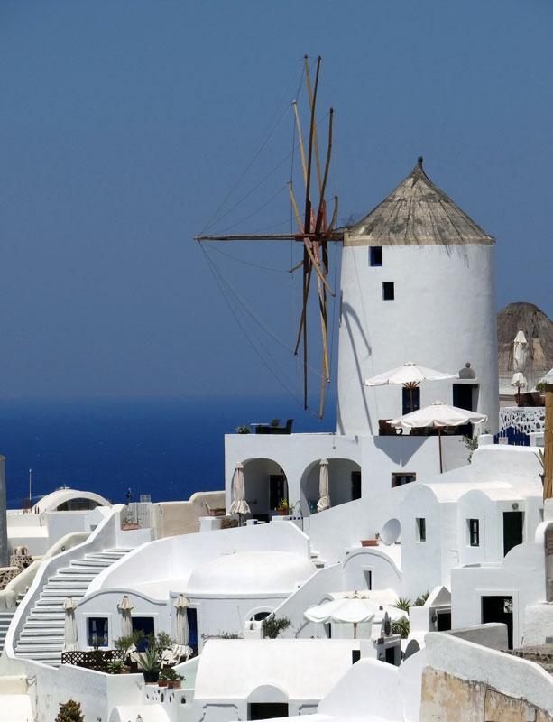 Old windmill in Santorini (Thira) overlooking the Mediterranean.