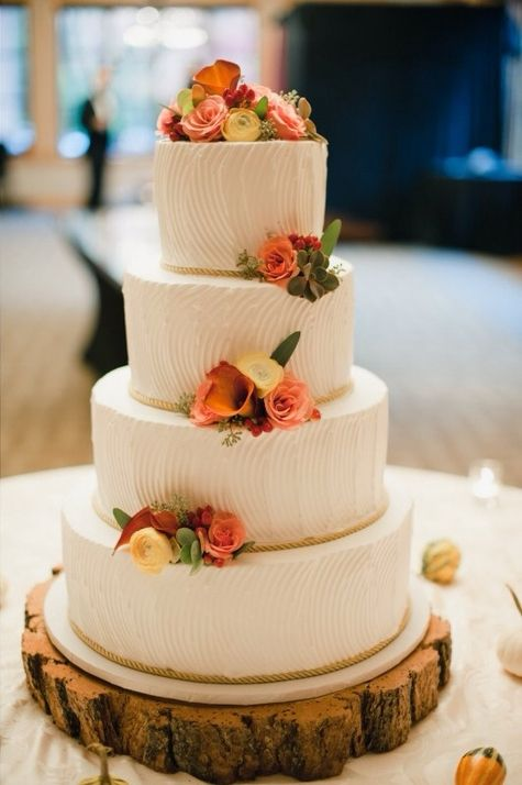 Fall wedding cake topped with ranunculus, calla lilies and succulents