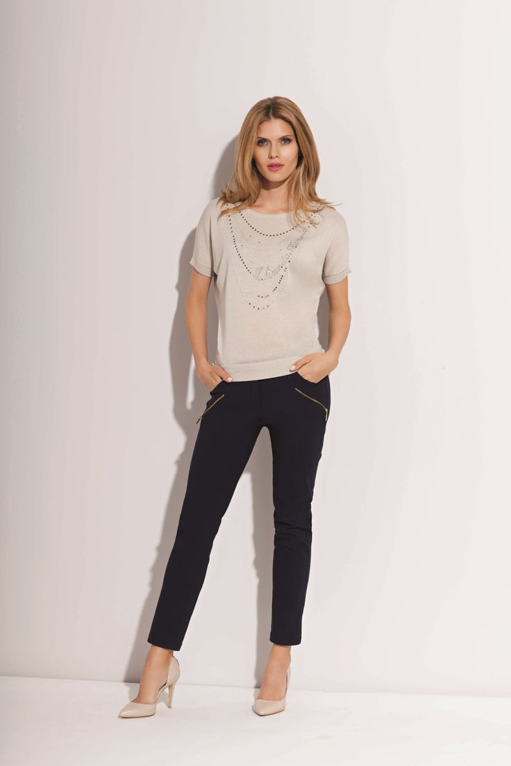 there are elegant blouse and classic trousers