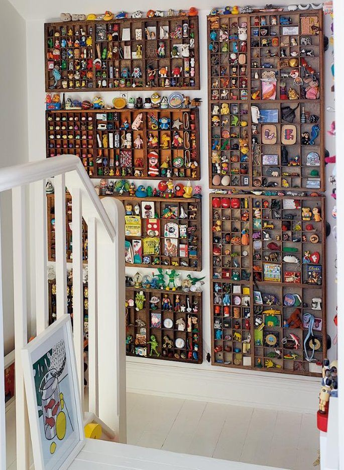 A 'gallery wall' made from letterpress trays & retro toys