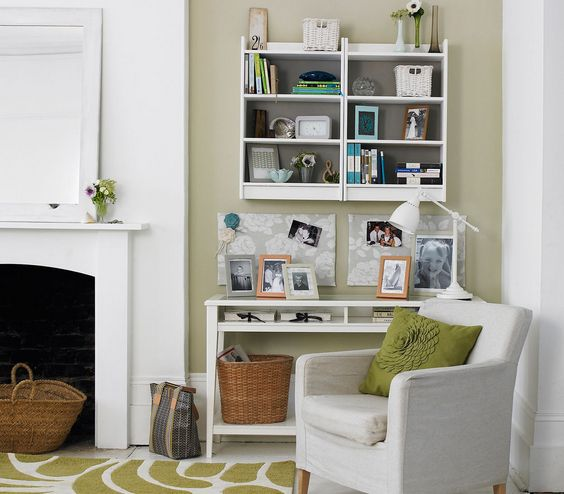 Home office | 33 Modern Living Room Design Ideas | Real Simple  Office Space Create a petite home office in your living room that's big on style: Instead of a traditional desk chair (that would look out of place) appoint a living room chair that looks good facing the desk or the rest of the space.