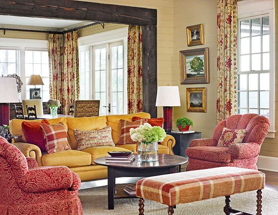 Plush-backed armchairs and a rolled-arm sofa make for comfy seating in this living room - Traditional Home®  Photo: Emily Followill