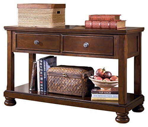 Add that finishing touch of traditional style to your space with the Porter sofa table. A burnished finish and classic bun feet exude a sense of relaxed elegance. Dual drawers and a Bottom shelf give you the option of hiding things away or showing things off. 2 drawers with drop-down fronts. LH... more details available at https://furniture.bestselleroutlets.com/accent-furniture/sofa-console-tables/product-review-for-ashley-furniture-signature-design-porter-sofa-table-rustic-