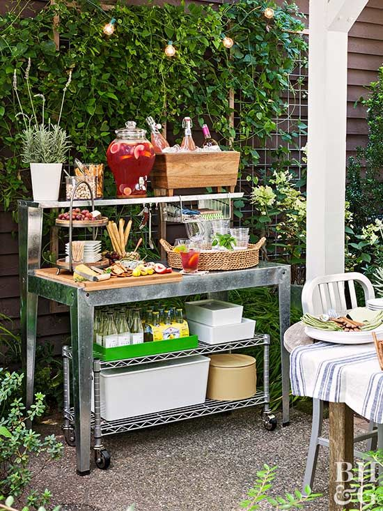 To create an outdoor party station, first, pick a sturdy potting bench with a large counter for serving and a shelf wide enough to hold a drink dispenser.